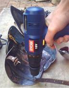 removing an old rivet can be as easy as drilling out the back or flat of the rivet.